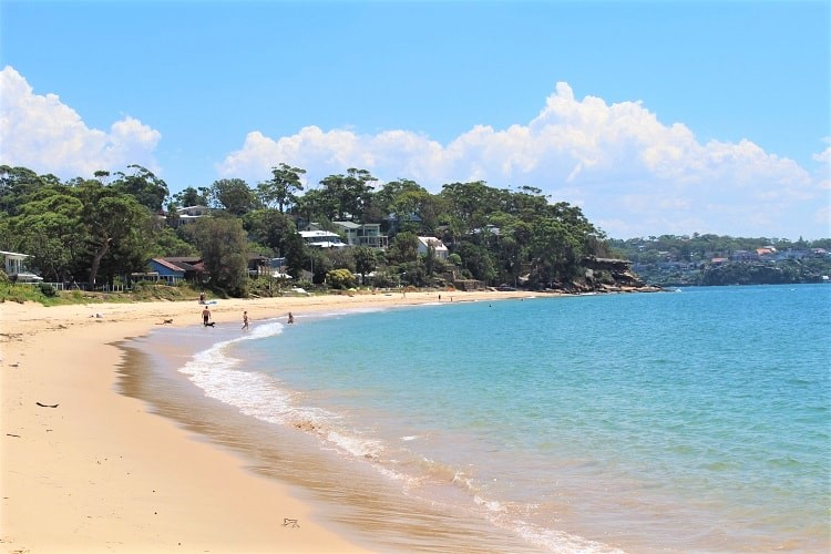A guide to Bundeena, Maianbar & Bonnie Vale campground in the Royal National Park, Australia. Enjoy a beautiful Sydney day trip taking the Bundeena ferry from Cronulla to Bundeena Beach. Go on the short walk to scenic Maianbar and explore multiple beaches, including the huge Jibbon Beach.