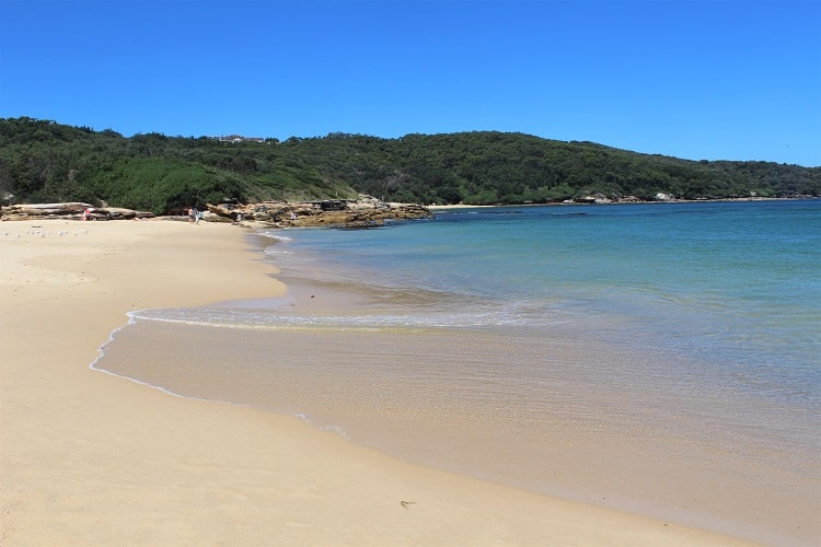 Congwong Beach in Sydney on a lovely sunny day with clear water rolling in.
