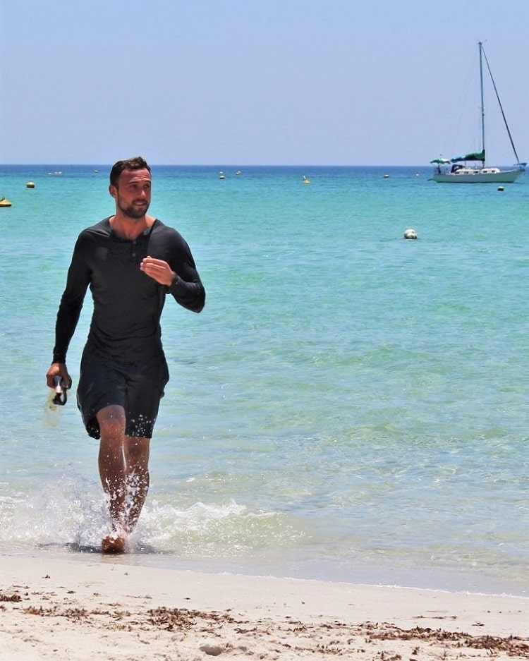 German backpacker coming out of the ocean in Dunsborough.