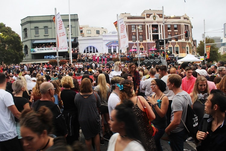 Visitors and locals waiting on Oxford Street at the start of Mardi Gras Sydney.