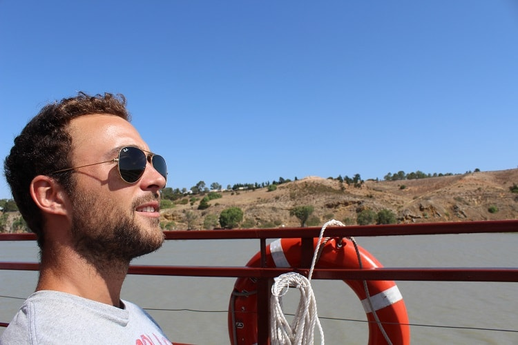 Tourist enjoying a Murray River paddle boat cruise in South Australia.