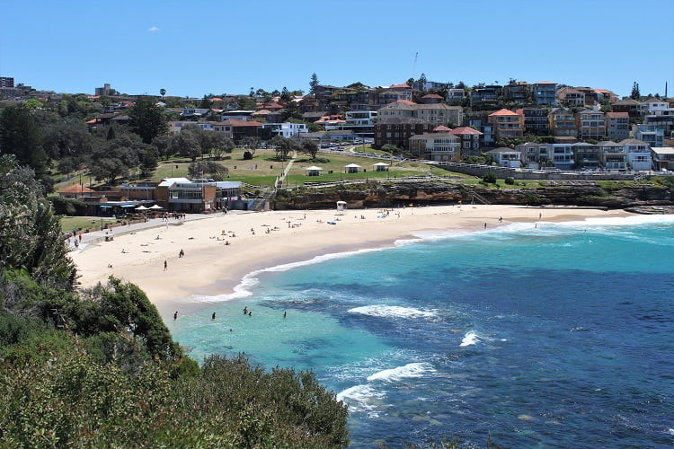 Beautiful Bronte Beach viewed from the cliffs on the Bondi to Coogee walk during Sculptures by the Sea Sydney.