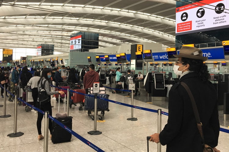 Long queues to check in for a London to Hong Kong flight during Covid-19.