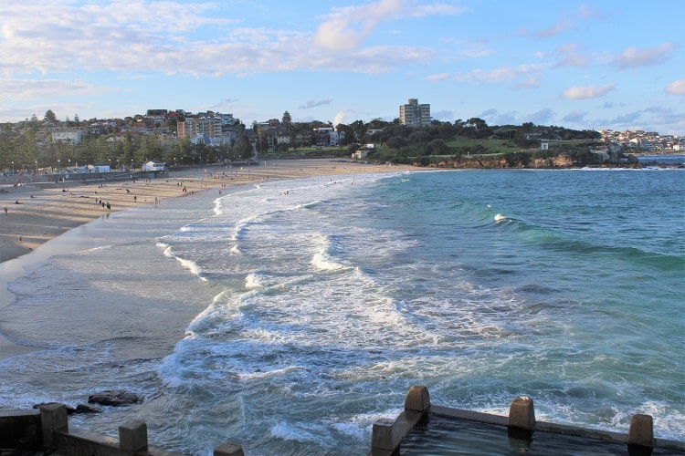 Huge Coogee Beach in Sydney viewed from above the ocean pool. It's one of the most popular of the Eastern Suburbs beaches in Sydney.