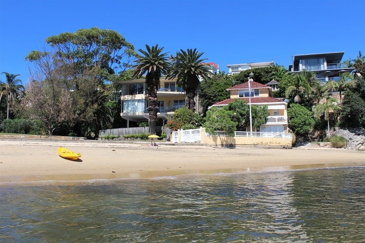Gibsons Beach and waterfront mansions in Watsons Bay on a sunny day.