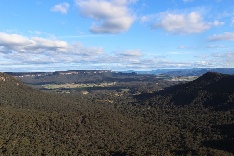 Sweeping views across the Blue Mountains and the flat countryside at Mount Victoria from Mitchell Ridge lookout.