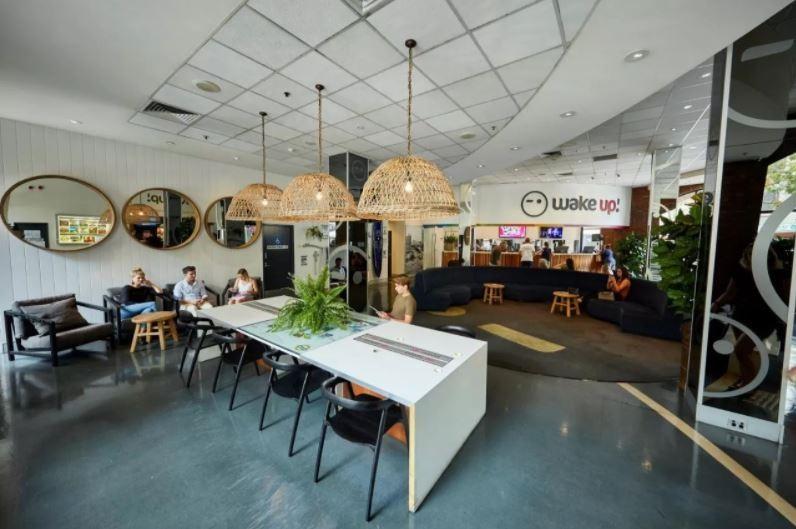 Modern reception area at Wake Up hostel in Sydney CBD.
